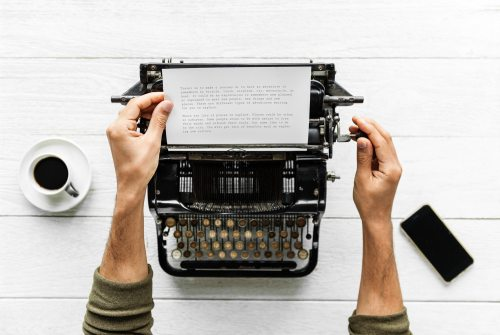 report-writing-typewriter